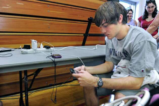 Connor Holmes, 17, of Ridgefield, was at the shelter set-up in Ridgefield, to charge his cell phone. Town residents were out of electricity as a result of Tropical Storm Irene. Photo taken Monday, Aug. 29, 2011. Photo: Carol Kaliff