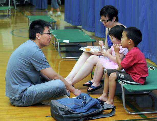 "Lint Hai, left, and Sophie Suo of Ridgefield, brought their children to the town shelter in Ridgefield Monday, for a shower and a snack. ""Showers are a big problem,"" Suo says. Photo taken Monday, Aug. 29, 2011. Photo: Carol Kaliff"