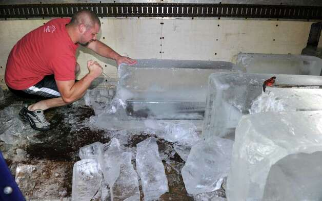 Rick Markey, an employee at The Ice House in Danbury, chips ice from huge blocks for a customer. The House made extra ice in anticipation of Hurricane Irene so they could service the people who are out of electricity. Photo taken Monday, August 29, 2011. Photo: Carol Kaliff