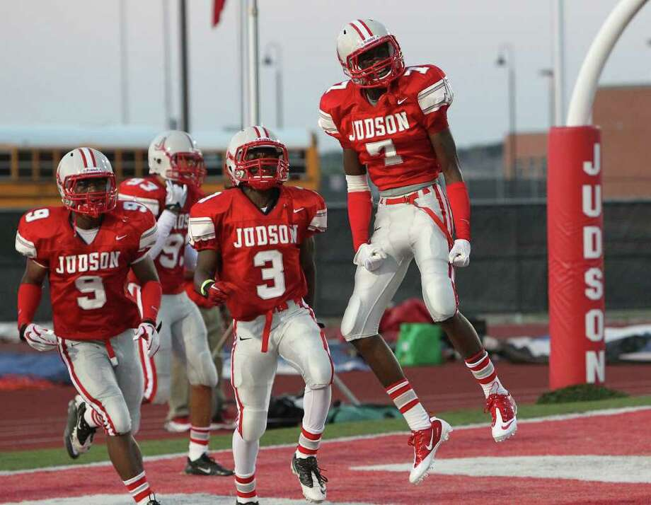 Judson safety Tre Flowers (right) celebrates after returning an interception for a TD in the top-ranked Rockets' 49-0 victory against MacArthur last week. Photo: Kin Man Hui/kmhui@express-news.net / San Antonio Express-News