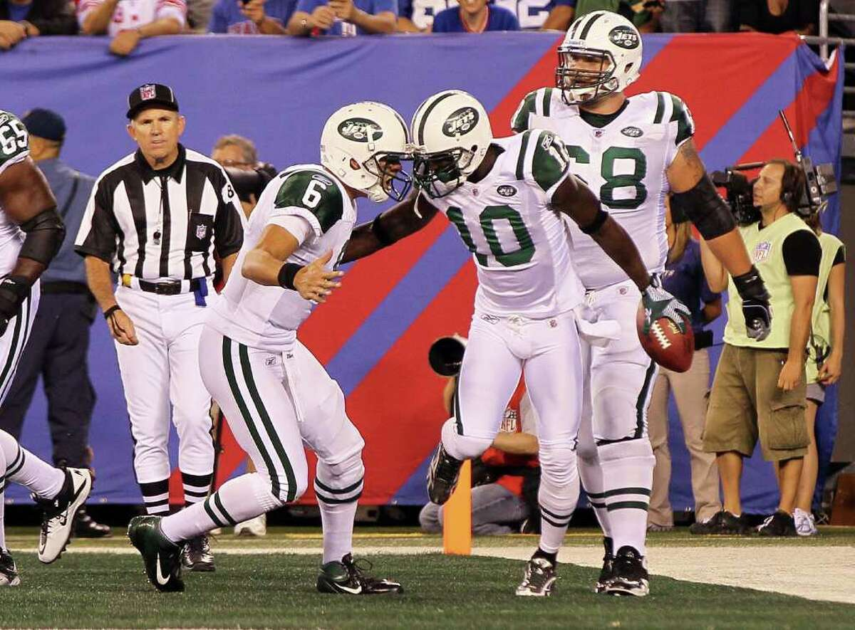 EAST RUTHERFORD, NJ - AUGUST 29: Santonio Holmes #10 of the New York Jets celebrates his second quarter touchdown reception against the New York Giants with teammate Mark Sanchez during their pre season game on August 29, 2011 at MetLife Stadium in East Rutherford, New Jersey. (Photo by Jim McIsaac/Getty Images)