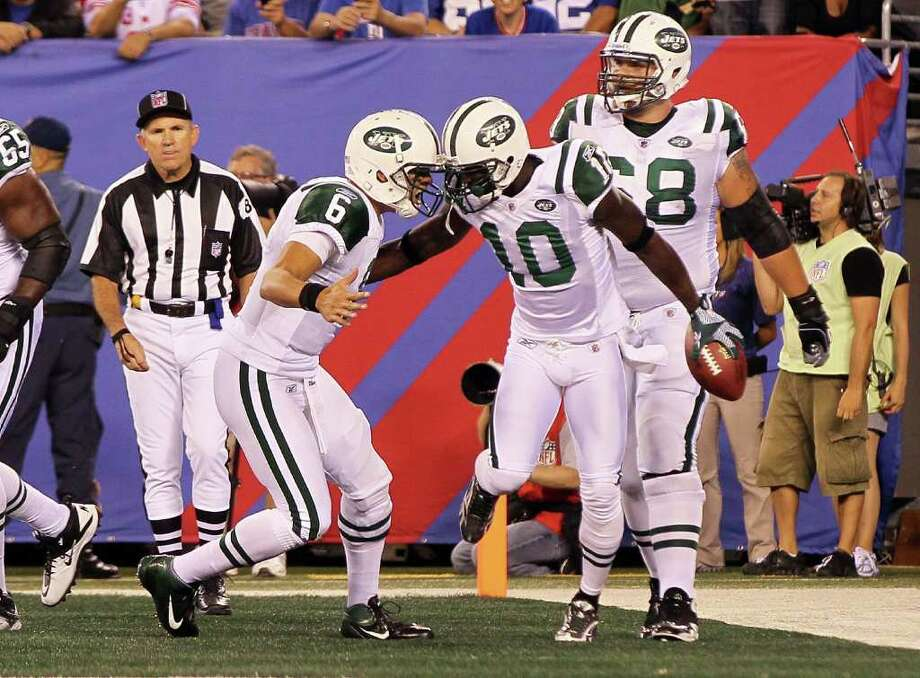 EAST RUTHERFORD, NJ - AUGUST 29:  Santonio Holmes #10 of the New York Jets celebrates his second quarter touchdown reception against the New York Giants with teammate Mark Sanchez during their pre season game on August 29, 2011 at MetLife Stadium in East Rutherford, New Jersey.  (Photo by Jim McIsaac/Getty Images) Photo: Jim McIsaac, Getty / 2011 Getty Images
