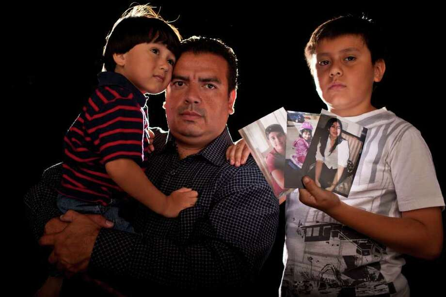"Omar Nuño with his children Leonardo, 2, and Sebastian, 8, at their home August 25, 2011 in Houston. Two teens are on trial for the September 2010 wreck during an afterschool race that killed his wife and two of his children. ""My kids were cheated,"" Nuño said. ""My little girl was six. He was 14. That's too young to be killed by two teenagers playing around with cars."" Mayra Castillo Torres, 37, Christopher Nuño a Jersey Village High School freshman and Katia Nuño all died after the minivan they were in was broadsided by a sport utility vehicle, allegedly driven by a 17-year-old at the intersection of North Gessner and Brookriver. Former Jersey Village High School students Christopher Yovino and Brett Taylor, accused of racing each other which caused the wreck, each face 20 years in prison if convicted of manslaughter.  (Eric Kayne/For the Chronicle) Photo: Eric Kayne / © 2011 Eric Kayne"