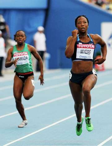 USA's Marshevet Myers (right) and Comoros' Feta Ahamada compete in a heat for the Women's 100m at the World Athletics Championships in Daegu, South Korea, Sunday, Aug. 28, 2011. Photo: Anja Niedringhaus/Associated Press