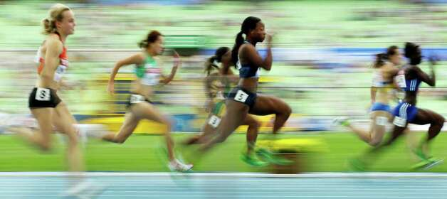 USA's Marshevet Myers (center) competes during a heat for the Women's 100m at the World Athletics Championships in Daegu, South Korea, Sunday, Aug. 28, 2011. Photo: Kevin Frayer/Associated Press