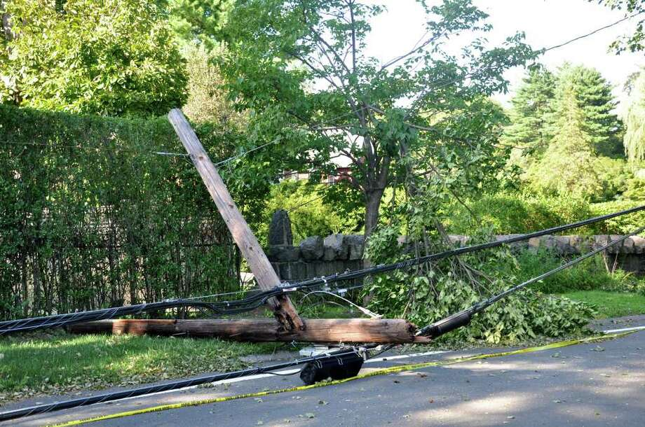 A telephone pole, which was snapped in half, lays on the road along with downed wires on Byram Shore Road near the intersection of James Street in Greenwich following Hurricane Irene on Monday, Aug. 29, 2011. Photo: Amy Mortensen / Connecticut Post Freelance