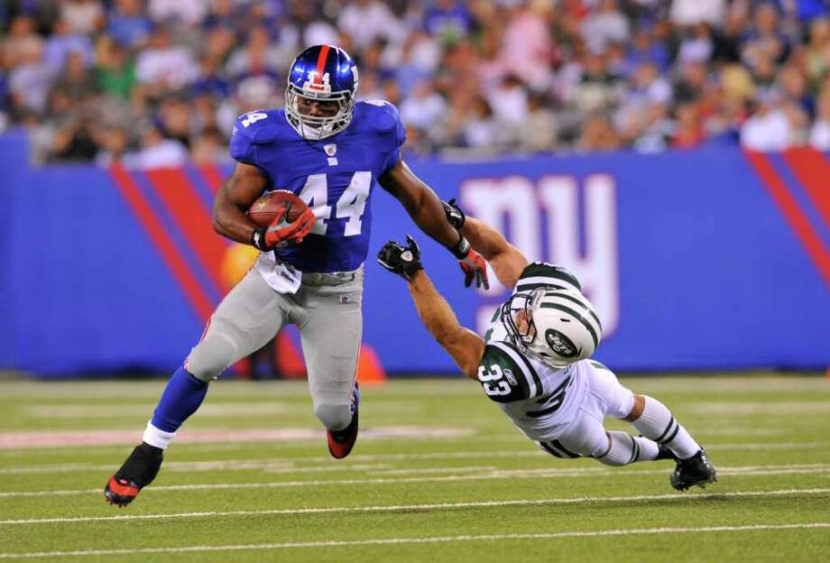 Giants running back Ahmad Bradshaw eludes the reach of Jets safety Eric Smith en route to a big gain in the second quarter of Monday night's game. The Jets won 17-3. Photo: David Pokress, McClatchy-Tribune News Service / Newsday