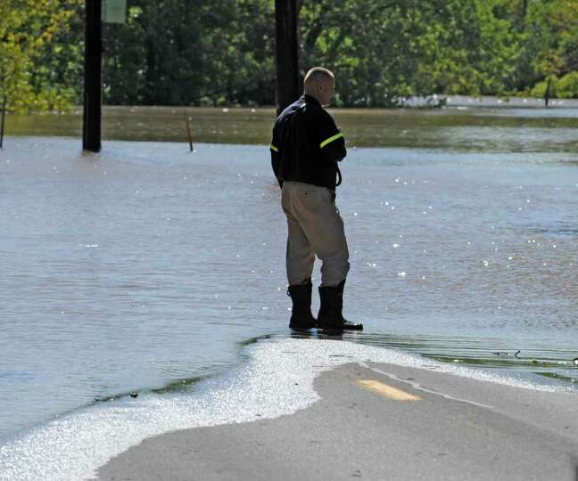 A lone fire officials plans his next move at the end of the road in Rotterdam Junction N.Y. Aug. 29,