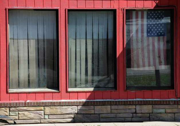 The shades on the inside of a karate center in Middleburg, N.Y. show the height of the water from aftermath of the flooding Aug. 29, 2011.   (Skip Dickstein / Times Union) Photo: SKIP DICKSTEIN / 2011