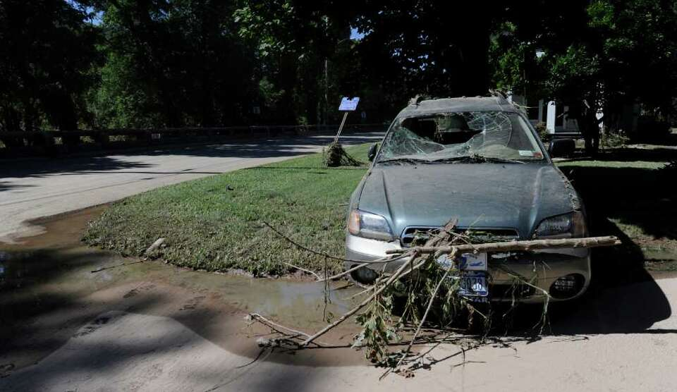 A car sits damaged from the floods in Middleburg, N.Y. Aug. 29, 2011.   (Skip Dickstein / Times Unio