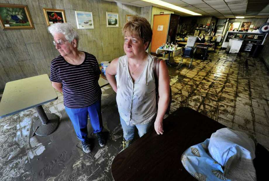 Loretta Kennedy, left for whom the business is named and her daughter Patricia Wainwright, right look over the damage to their business Mrs. K's Restaurant in Middleburg, N.Y. Aug. 29, 2011.   (Skip Dickstein / Times Union) Photo: SKIP DICKSTEIN / 2011