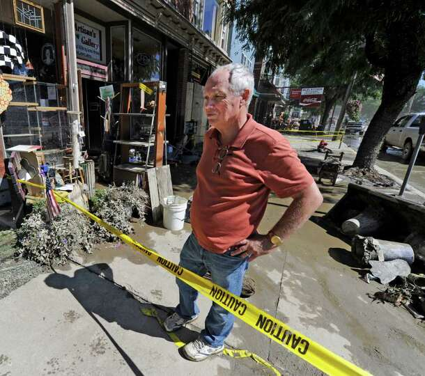 Middleburg Town Supervisor Dennis Richards looks over the damage to his town after a flood devastate