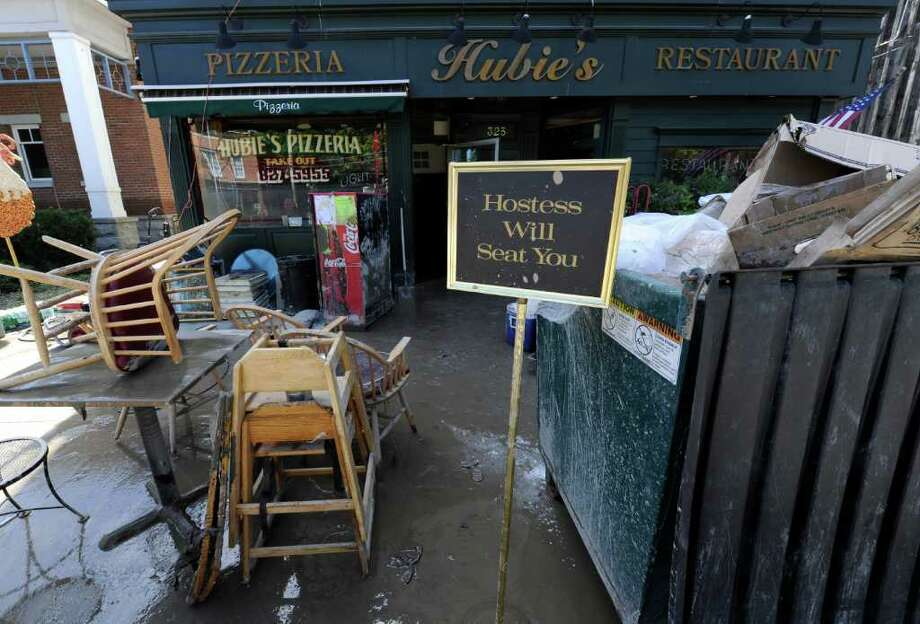 Mud covers furniture from Hubie's Pizzeria in Middleburg, N.Y. Aug. 29, 2011.   (Skip Dickstein / Times Union) Photo: SKIP DICKSTEIN / 2011