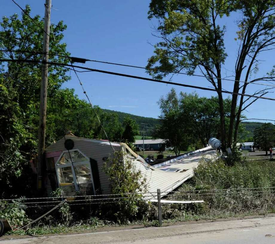 A mobil home lies smashed on the southern portion of Main Street in Schoharie, N.Y. Aug. 29, 2011.   (Skip Dickstein / Times Union) Photo: SKIP DICKSTEIN / 2011
