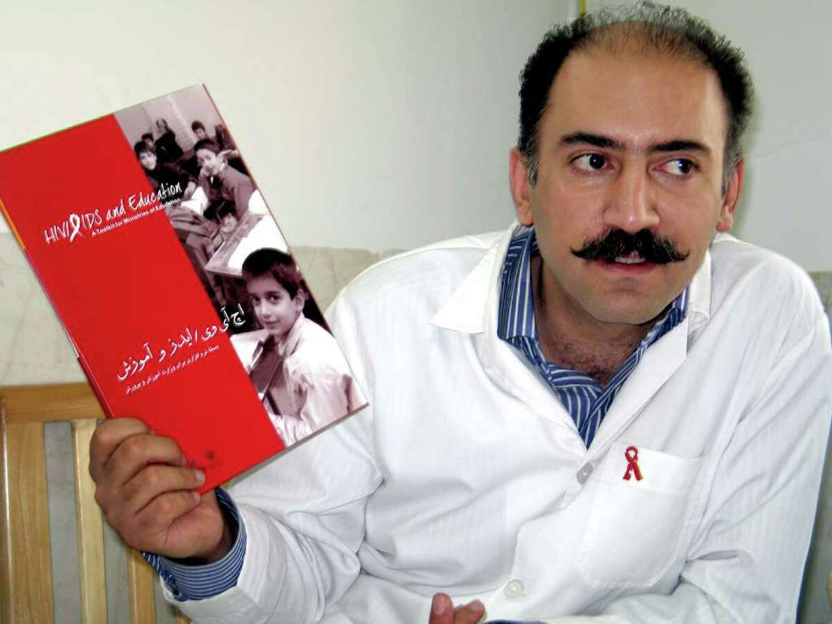 Dr. Arash Alaei, the main architect of Iran's acclaimed national HIV-prevention program, displays the awareness booklet he helped create for distribution among Iranian high school students. He said it took 30 rounds of negotiation with government officials to make the book modest enough for Iran's conservative Islamic government to support. (Hannah Allam/KRT)