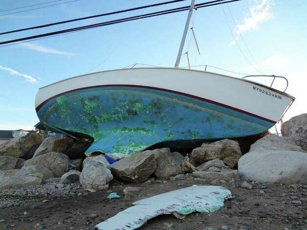 A boat that has been washed up onto a rock wall by Tropical Storm Irene on Harbor Road in Westport, CT. Photo: Ralph Filardo / Hearst CT Media Group