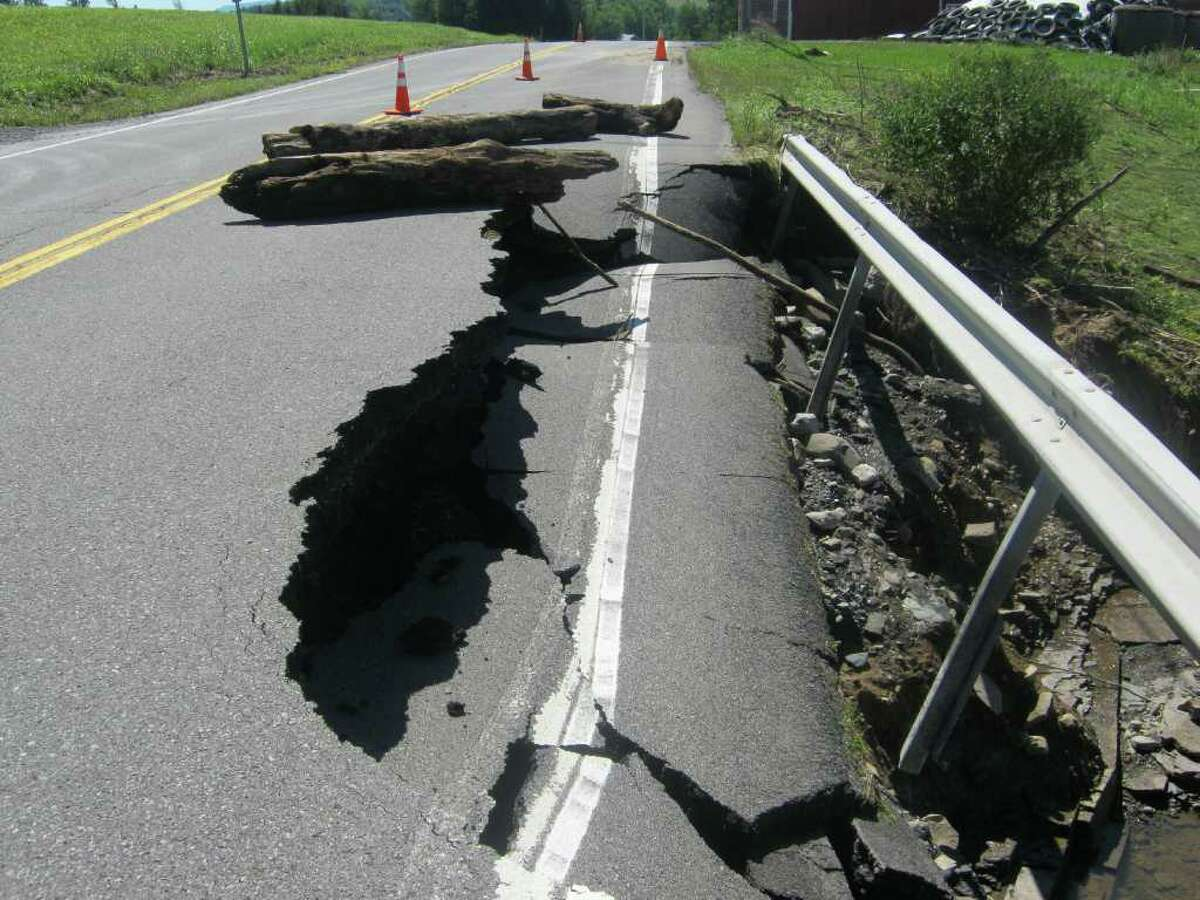 Part of Route 143 in Westerlo is washed away as a result of flooding Monday Aug. 29, 2011. (Tim O'Brien / Times Union)