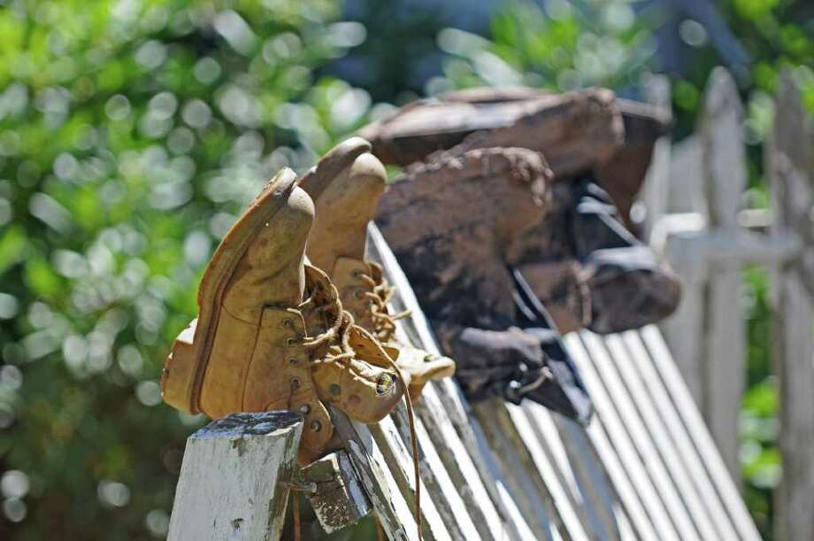 Boots drying in the sun on Main Street while work continues on cleaning up the damage from Hurricane Irene,  on Monday Aug. 29, 2011,  in Windham, NY.   (Philip Kamrass / Times Union) Photo: Philip Kamrass