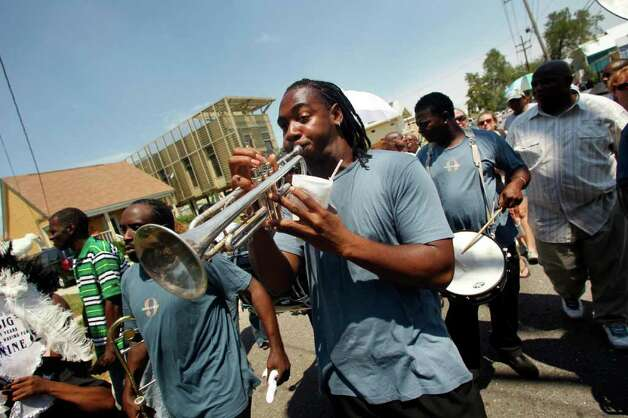 A member of the Big 9 marching club plays trumpet in a second line  commemorating the sixth anniversary of Hurricane Katrina in New Orleans, Monday, Aug. 29, 2011. (AP Photo/Gerald Herbert) Photo: Gerald Herbert