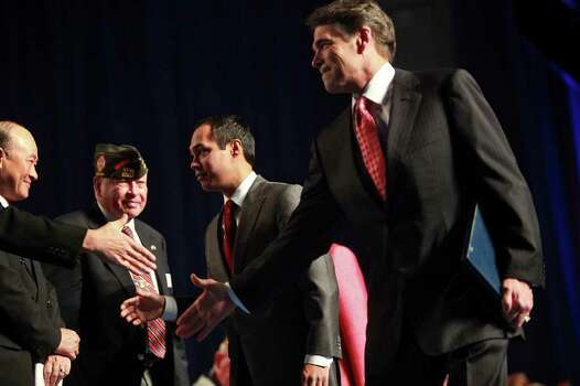 Governor Rick Perry, right, and Mayor Julian Castro shake hands with participants as they leave the stage after speaking at the Veterans of Foreign Wars National Convention at the Henry B. Gonzalez Convention Center in San Antonio on Monday, August 29, 2011. Photo: LISA KRANTZ, LISA KRANTZ/lkrantz@express-news.net / lkrantz@express-news
