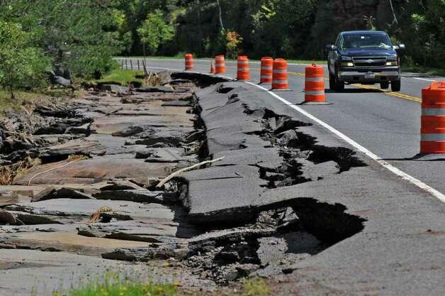 Traffic heads west on Route 23 past roadway damaged during Hurricane Irene, on Monday Aug. 29, 2011,  near Windham, NY.   (Philip Kamrass / Times Union) Photo: Philip Kamrass
