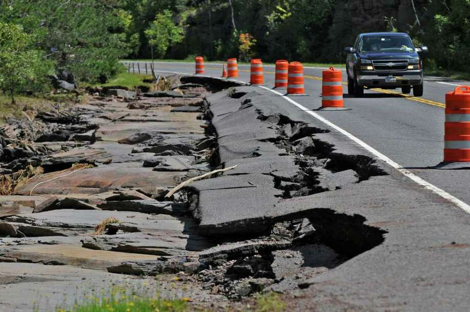 Traffic heads west on Route 23 past roadway damaged during Hurricane Irene, on Monday Aug. 29, 2011,  near Windham, NY.   (Philip Kamrass / Times Union) Photo: Philip Kamrass
