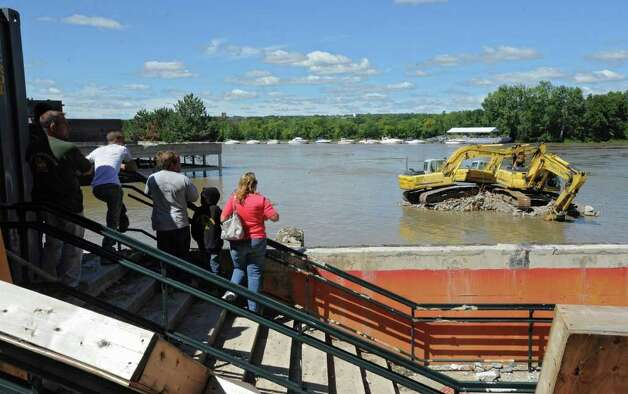 People take photos of construction equipment stranded in the water which overflowed from the Hudson River in Troy, N.Y. on Monday, Aug. 29, 2011. Hurricane Irene caused major damage and flooding in the Capital District. (Lori Van Buren / Times Union) Photo: Lori Van Buren