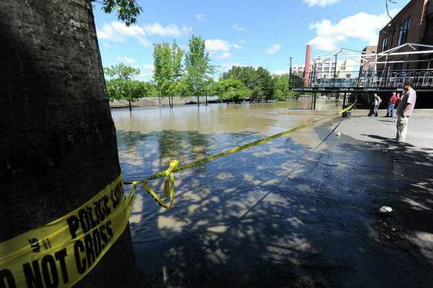 The parking lot and docks behind Ryan's Wake, Jose Malone and Brown's Brewery is flooded from water which overflowed from the Hudson River in Troy, N.Y. on Monday, Aug. 29, 2011. Hurricane Irene caused major damage and flooding in the Capital District. (Lori Van Buren / Times Union) Photo: Lori Van Buren