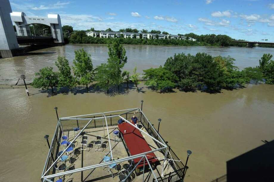 The parking lot and docks behind Ryan's Wake is flooded from water which overflowed from the Hudson River in Troy, N.Y. on Monday, Aug. 29, 2011. Hurricane Irene caused major damage and flooding in the Capital District. (Lori Van Buren / Times Union) Photo: Lori Van Buren