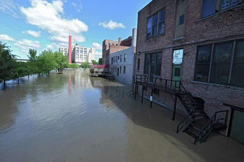 The parking lot and docks behind Ryan's Wake, Jose Malone and Brown's Brewery is flooded from water