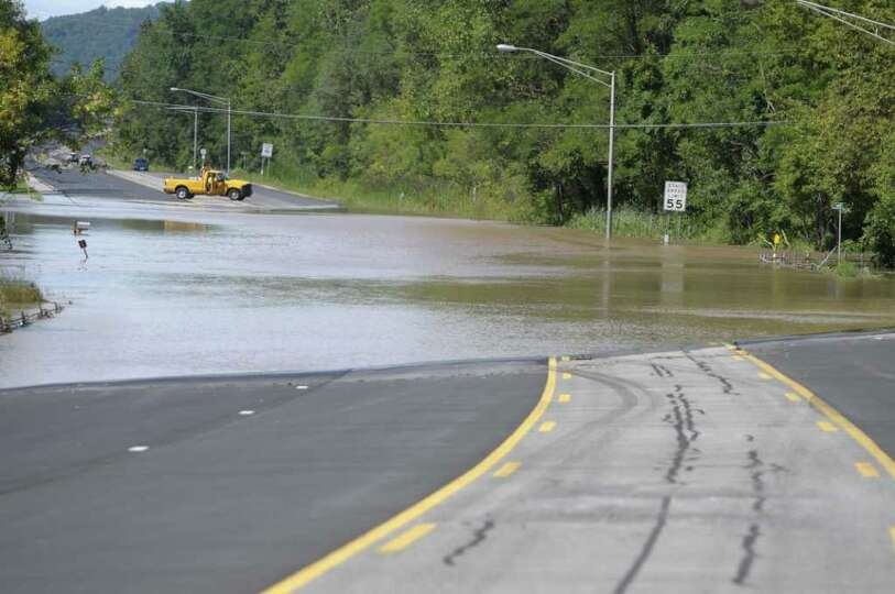 Route 5 is blocked by flood waters from the Mohawk River near Rotterdam Junction on Monday, Aug. 29,