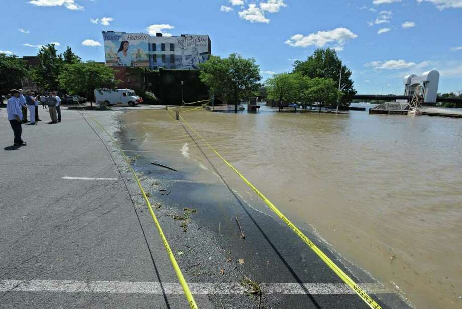The parking lot and docks near Ryan's Wake, Jose Malone and Brown's Brewery is flooded from water which overflowed from the Hudson River in Troy, N.Y. on Monday, Aug. 29, 2011. Hurricane Irene caused major damage and flooding in the Capital District. (Lori Van Buren / Times Union) Photo: Lori Van Buren