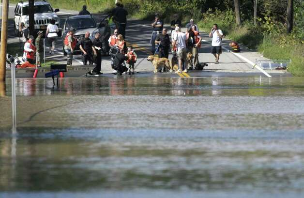Residents gather on one side of Route 5s in Rotterdam Junction on Monday, Aug. 29, 2011 as they wait to be evacuated.  Rotterdam Junction residents were evacuated by boat carrying them across a flooded section of Route 5s. (Paul Buckowski / Times Union) Photo: Paul Buckowski  / 00014438B