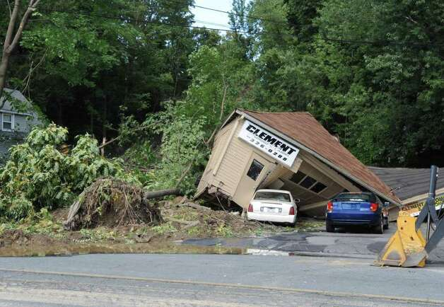 Several houses along Rt. 2 were destroyed by a landslide in Troy, N.Y. on Monday, Aug. 29, 2011. Hurricane Irene caused major damage and flooding in the Capital District. (Lori Van Buren / Times Union) Photo: Lori Van Buren