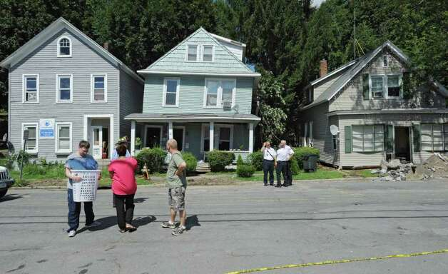 Several houses along Rt. 2 were destroyed by a landslide in Troy, N.Y. on Monday, Aug. 29, 2011. Here firefighters retrieve belongings to families. Hurricane Irene caused major damage and flooding in the Capital District. (Lori Van Buren / Times Union) Photo: Lori Van Buren