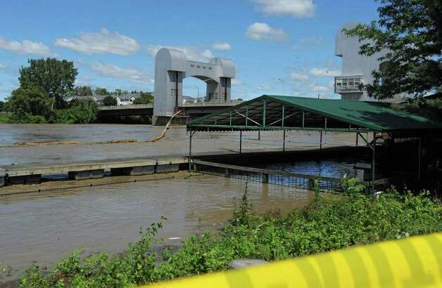 A tree floats down river past the Dinosaur Barbecue restaurant which flooded from water that overflowed from the Hudson River in Troy, N.Y. on Monday, Aug. 29, 2011. Hurricane Irene caused major damage and flooding in the Capital District. (Lori Van Buren / Times Union) Photo: Lori Van Buren
