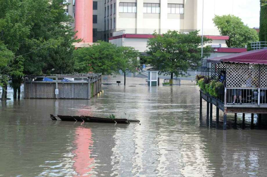 A broken fence floats down the parking lot  behind Ryan's Wake, Jose Malone's and Browns Brewery which is flooded from water which overflowed from the Hudson River in Troy, N.Y. on Monday, Aug. 29, 2011. Hurricane Irene caused major damage and flooding in the Capital District. (Lori Van Buren / Times Union) Photo: Lori Van Buren