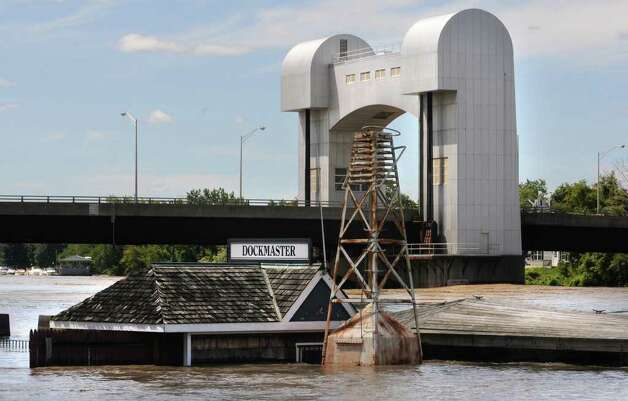 The dockmaster house by the parking lot  behind Ryan's Wake, Jose Malone's and Browns Brewery is flooded from water which overflowed from the Hudson River in Troy, N.Y. on Monday, Aug. 29, 2011. Hurricane Irene caused major damage and flooding in the Capital District. (Lori Van Buren / Times Union) Photo: Lori Van Buren