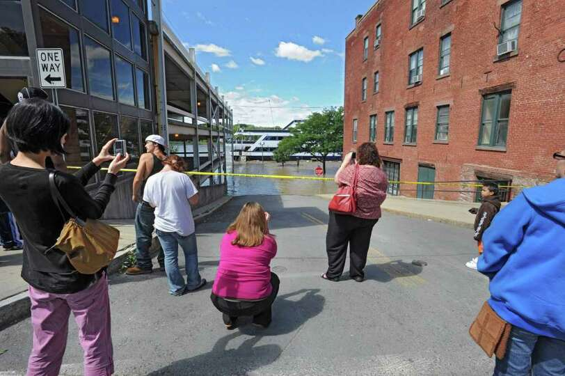 People take photos of the cruise chip which is stranded at the end of State St. from water which ove
