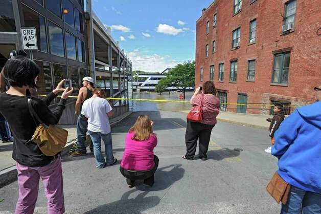 People take photos of the cruise chip which is stranded at the end of State St. from water which overflowed from the Hudson River in Troy, N.Y. on Monday, Aug. 29, 2011. Hurricane Irene caused major damage and flooding in the Capital District. (Lori Van Buren / Times Union) Photo: Lori Van Buren