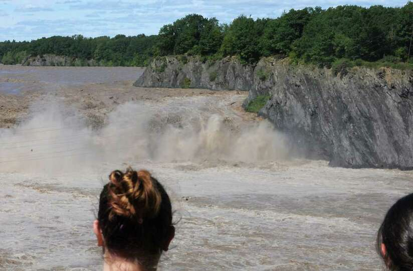 Intense water rushes over the Cohoes Falls in Cohoes, N.Y. on Monday, Aug. 29, 2011. Hurricane Irene
