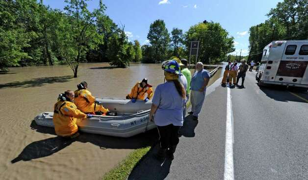 Mariaville Fire Company members launch a boat to evacuate residents of Rotterdam Junction, N.Y.  as water rises from the Mohawk River and floods homes in the area. (Skip Dickstein / Times Union) Photo: SKIP DICKSTEIN / 2011
