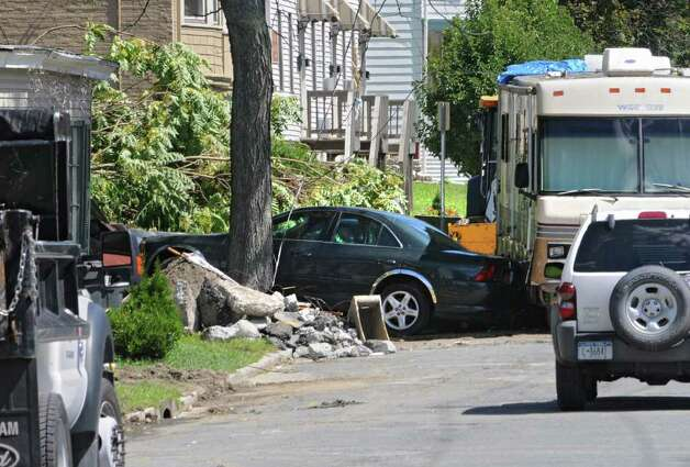 Several houses and cars along Rt. 2 were destroyed by a landslide in Troy, N.Y. on Monday, Aug. 29, 2011. Hurricane Irene caused major damage and flooding in the Capital District. (Lori Van Buren / Times Union) Photo: Lori Van Buren