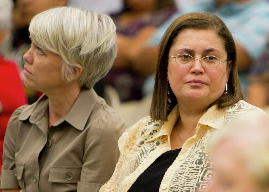 Jasmine Engineering CEO Jasmine Azima (right) sits next to Jasmine consultant Megan Augustine during a Harlandale school board special meeting at Rayburn Elementary School in San Antonio.