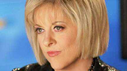 """FILE - This May 21, 2009 photo released by CNN, shows host Nancy Grace, in Atlanta. Grace will be one of eleven celebrities competing on the upcoming season of """"Dancing with the Stars."""""""