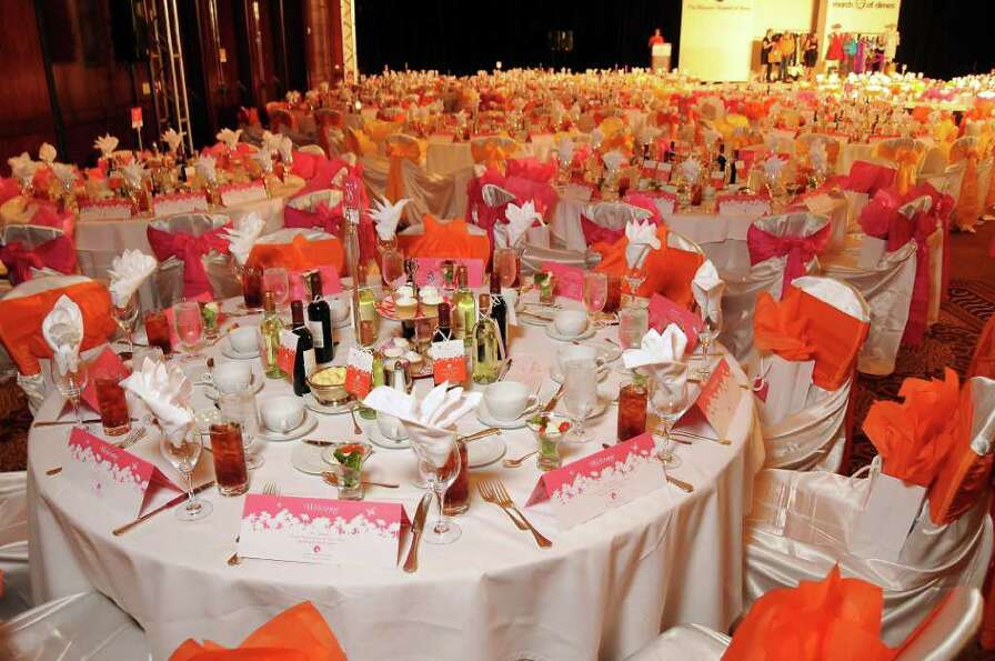 Tables at the Women's Hospital of Texas' luncheon were decorated in pink and orange.
