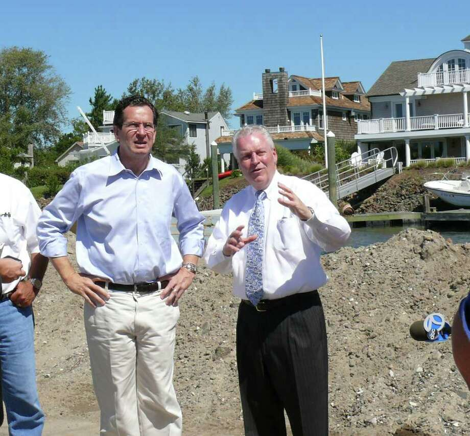 Gov. Dannel Malloy, left, gets a tour from interim First Selectman Michael Tetreau of some of the beach areas damaged by Hurricane Irene. Photo: Genevieve Reilly / Fairfield Citizen