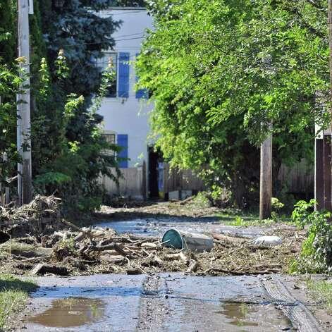 Flood debris blocked Earl in Waterford Tuesday Aug. 30, 2011.  (John Carl D'Annibale / Times Union) Photo: John Carl D'Annibale / 00014452A