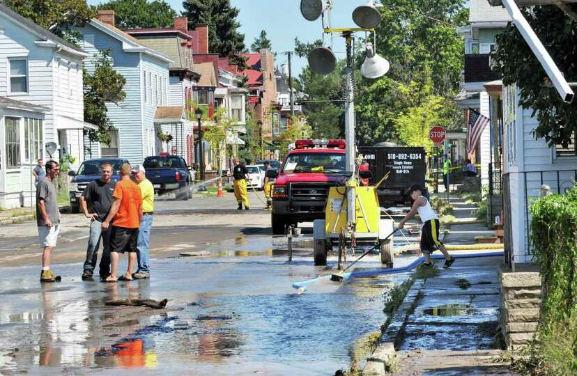 Clean up continues in the aftermath of storm flooding on Second Street in Waterford Tuesday Aug. 30,