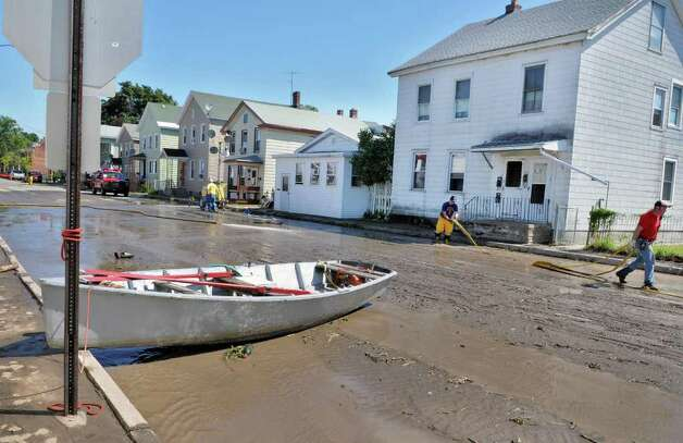 A row boat moored to a stop sign on Second Street as clean up continues in the aftermath of storm flooding on in Waterford Tuesday Aug. 30, 2011.  (John Carl D'Annibale / Times Union) Photo: John Carl D'Annibale / 00014452A